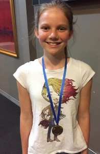 photo of Zoe Peck with her medal